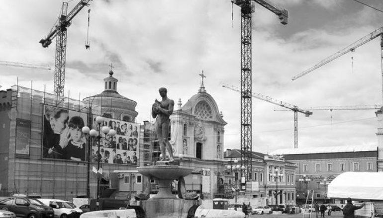 L'Aquila, mani e volti della ricostruzione